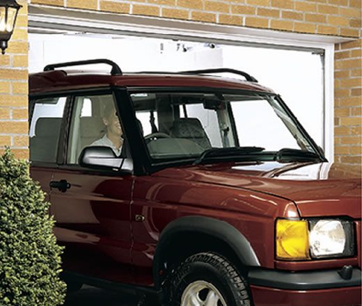 Garage doors garage door systems uk ireland for Drive through garage door